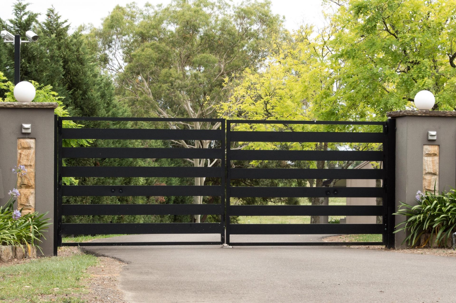black metal driveway entrance gates set